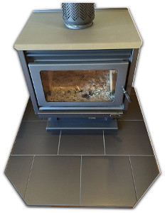 Heater installed on a hearth made by Orlik Heating